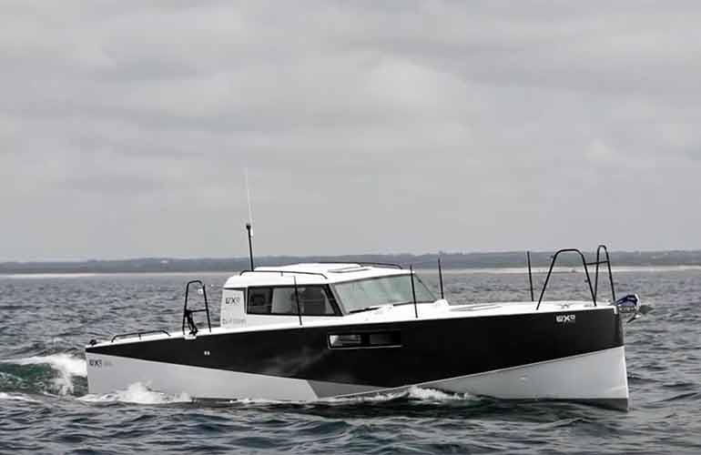 The Loxo32, a supremely fuel-efficient cruising boat, very much of its time!