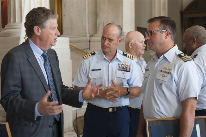 Rhode Island Lt. Gov. Dan McKee speaks with U.S. Coast Guard Capt. Virkaitis & Cmdr. McSorley at the State Capitol Building. McSorley is the Coast Guard Sector Southeastern New England Deputy Commander and spoke in support of Coast Guard Auxiliary members - photo © Petty Officer 3rd Class Zachary Hupp