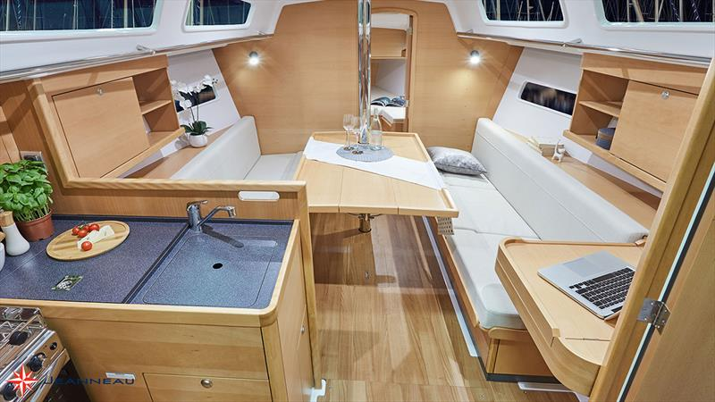 Jeanneau Sun Odyssey 319 - A generous interior with a comfortable galley and nav table - photo © Jeanneau France