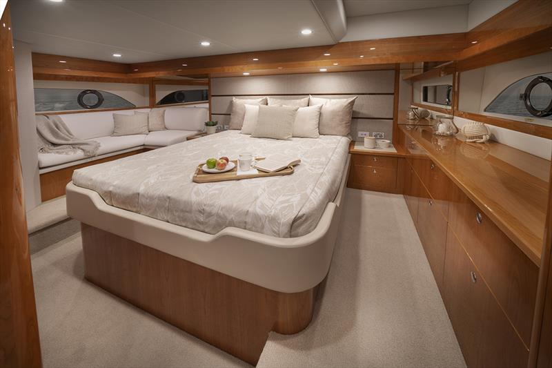 Riviera 54 Enclosed Flybridge boasts a luxurious full-beam master stateroom - photo © Riviera Studio