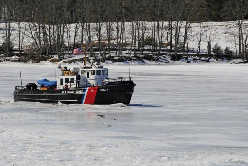 The crew of the Coast Guard Cutter Bridle breaks ice along the Kennebec River, in Gardiner, Maine, March 27, 2014. The Thunder Bay began icebreaking on the river to relieve flood potential as spring appears on the horizon. - photo © U.S. Coast Guard / Rob Simpson