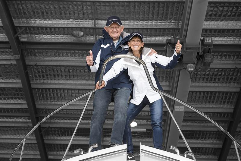 Tom Campbell and Beth David on the bow of their new Maritimo - photo © Murray Waite