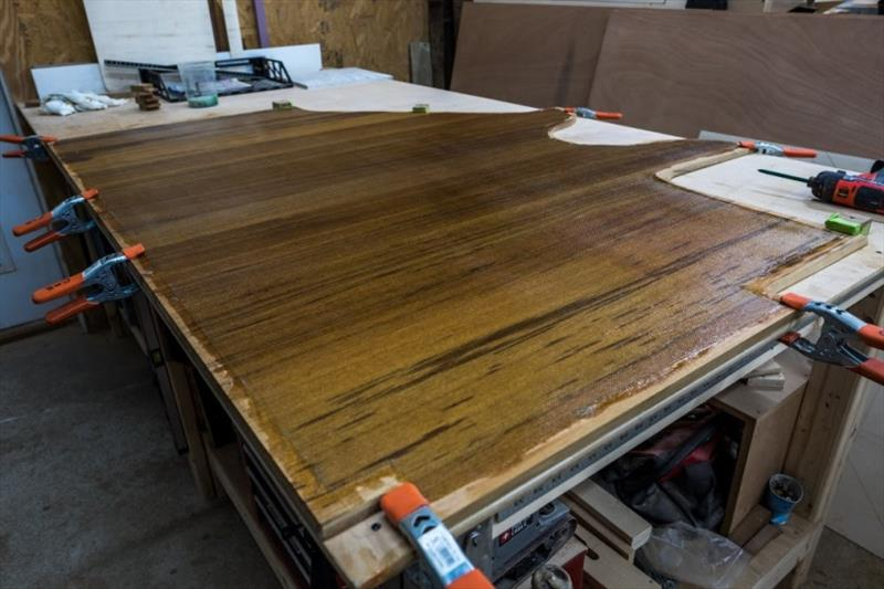 Lamination of teak floor for the master head - photo © Bayliss Boatworks