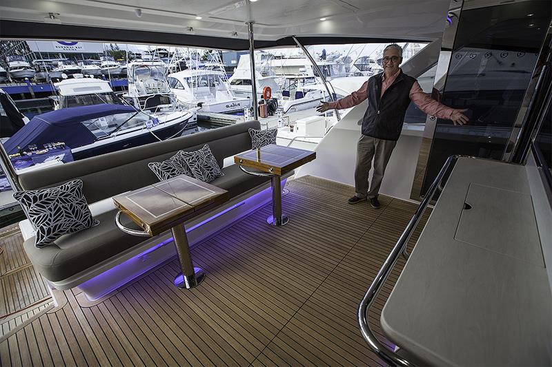 Stephen Milne, Brand & Communications Director, demonstrates where the extra room can be found on the mezzanine deck of the 72 Sports Motor Yacht - photo © John Curnow