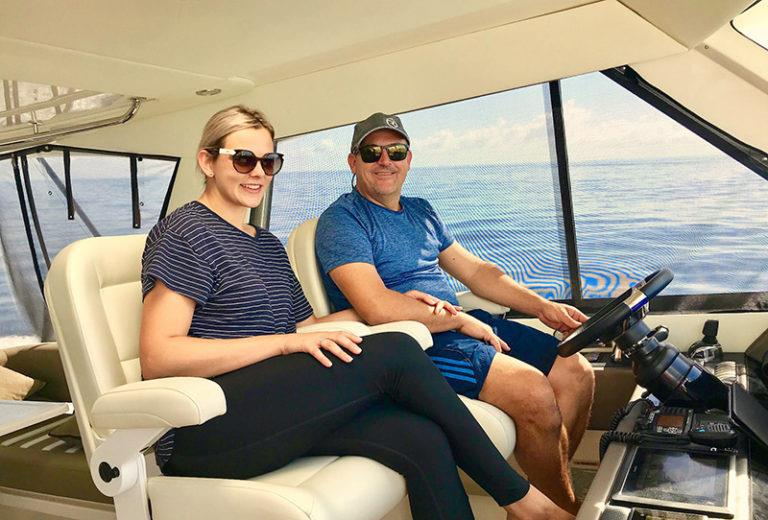 Russell and Gabriella at the helm. - photo © Riviera Australia