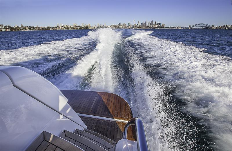 Running down the Harbour on board Maritimo's X60 - photo © John Curnow