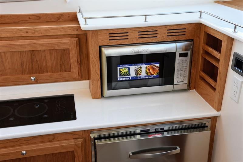Microwave moved to countertop level for easier access – Silverware drawer in top drawer where microwave used to be - photo © Jamie Governale