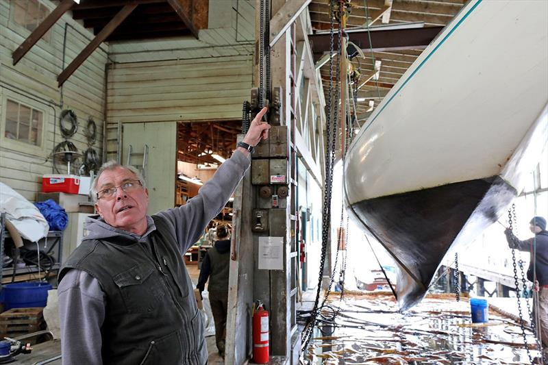 At Jensen Motor Boat Company, yard manager Peter Proctor will continue to be on hand until the sale is completed. At right, a wooden sailboat is hauled and cleaned before getting new paint on the hull. photo copyright Greg Gilbert / The Seattle Times taken at  and featuring the Power boat class