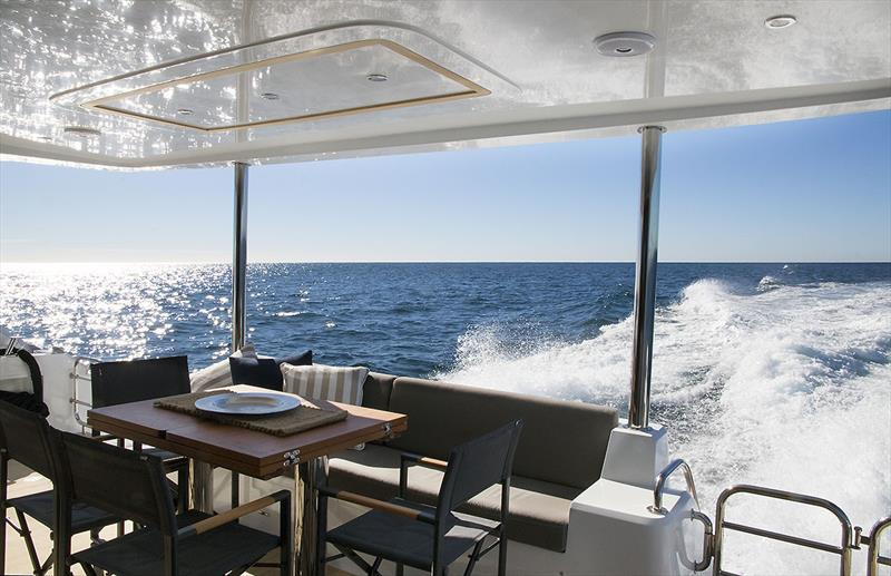 Out aft on the ILIAD 50, and it is almost within arm's reach of the galley, where there is also a breakfast bar - photo © Jennifer McKinnon