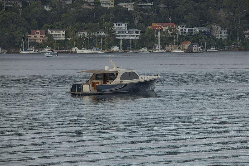 Despite the rain, this Palm Beach owner was enjoying the tranquility of Pittwater. - photo © John Curnow