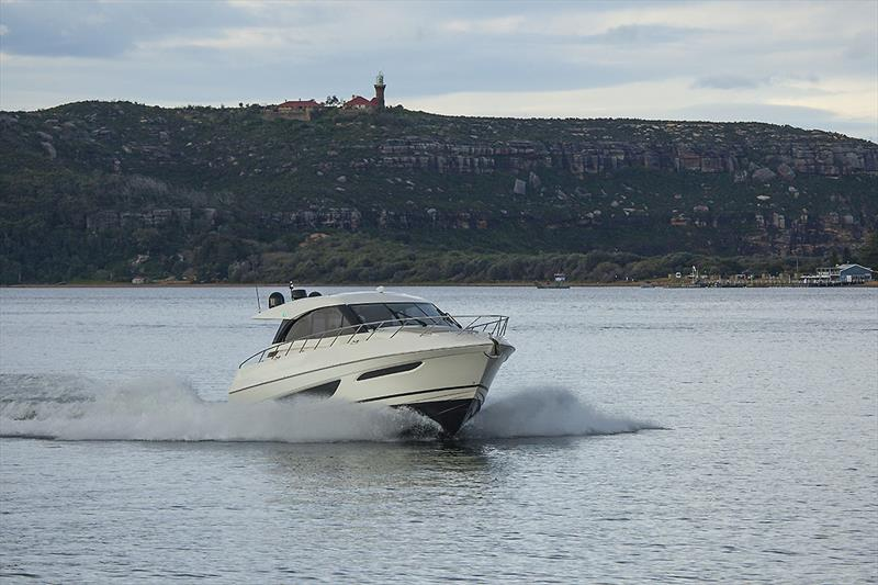 Charging back up Pittwater under the watchful eye of Barrenjoey Light. Flat water like this and the X50 will do 27 knots all day long. - photo © John Curnow