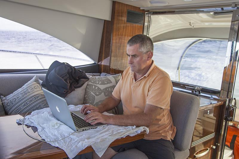 Working away on board Riviera's recently premiered and marvellous 4800 Sport Yacht Platinum Edition - photo © John Curnow