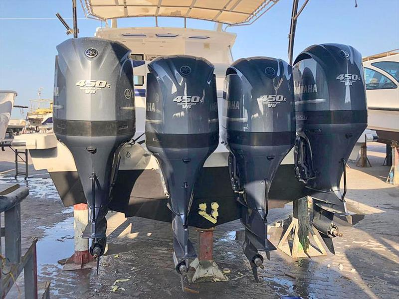 Finalising installation of the four Nizpro Marine 450s outboards on the Al Hareb Marine 56-footer. - photo © Al Murzem Trading