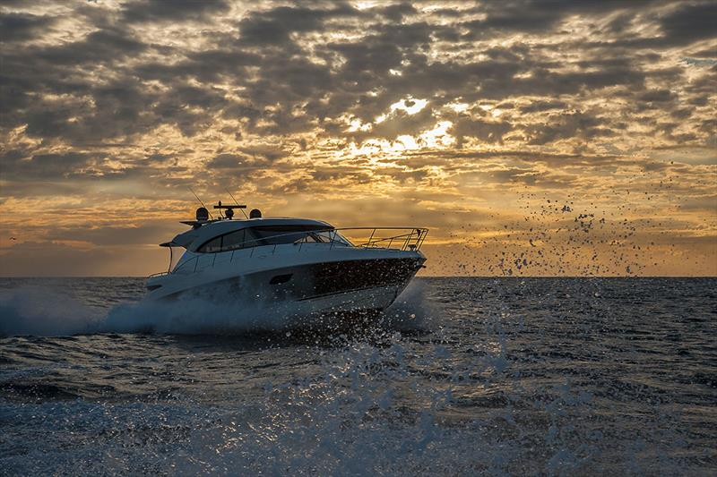 Just enough light around to know that this is the hugely popular Riviera 6000 Sport Yacht - Riviera trip Gold Coast to Sydney - photo © John Curnow