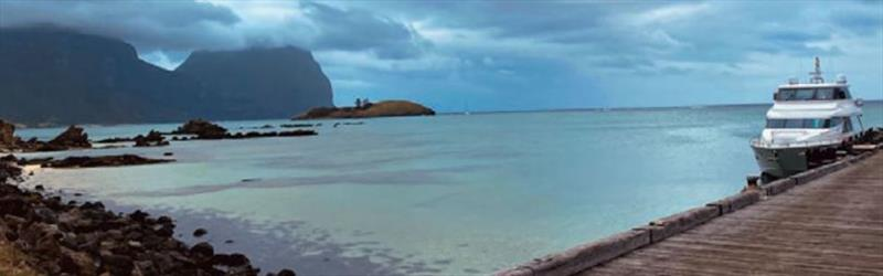 Enigma takes a break amidst the dramatic backdrop of Lord Howe Island in the Tasman Sea. - photo © Horizon Yachts