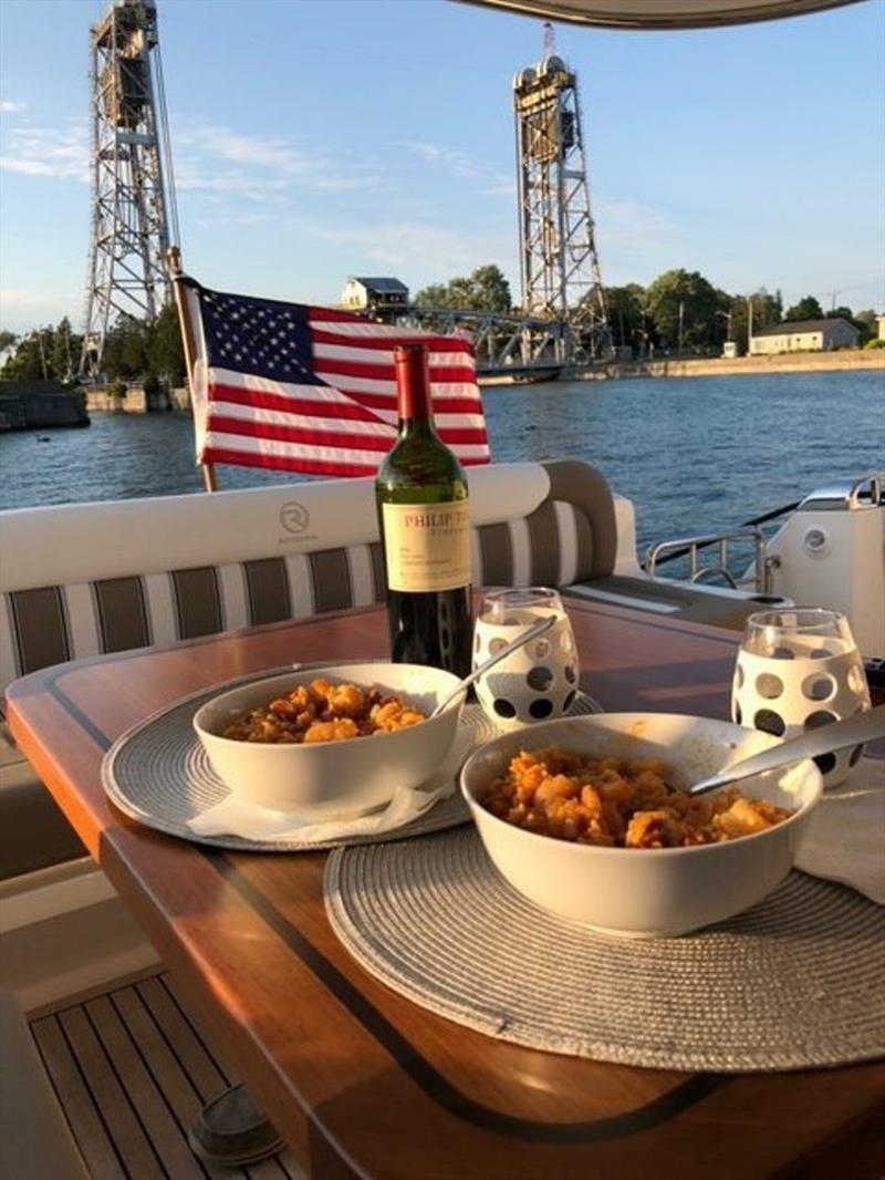Dinner with the Welland Canal in the background, leaving Lake Erie and into Lake Ontario - photo © Riviera Australia