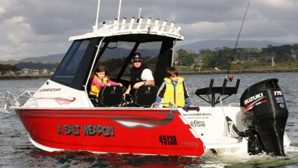 Boats can get you where the fishing action is. - Tasmanian boating © Carl Hyland