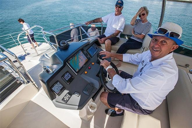 Andrew McLeod with some of the guests on the Aquila 44 ©  John Curnow