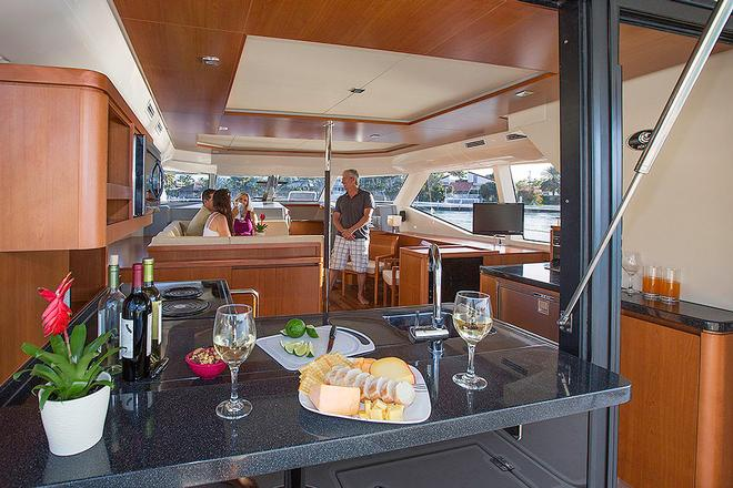 Galley operates easily for guests both indoors and out. © Multihull Central