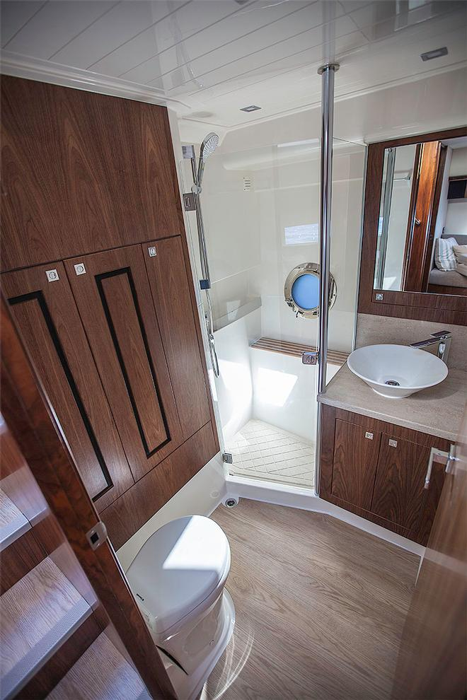Day or second head has the washer/dryer in behind the locker on the left. - Riviera 4800 Sport Yacht ©  John Curnow