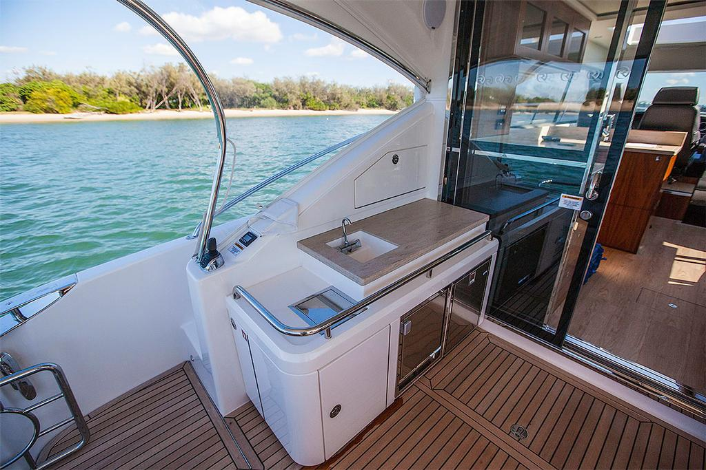 Aft joystick controller next to the fridge and icemaker under the prep bench. - Riviera 4800 Sport Yacht ©  John Curnow