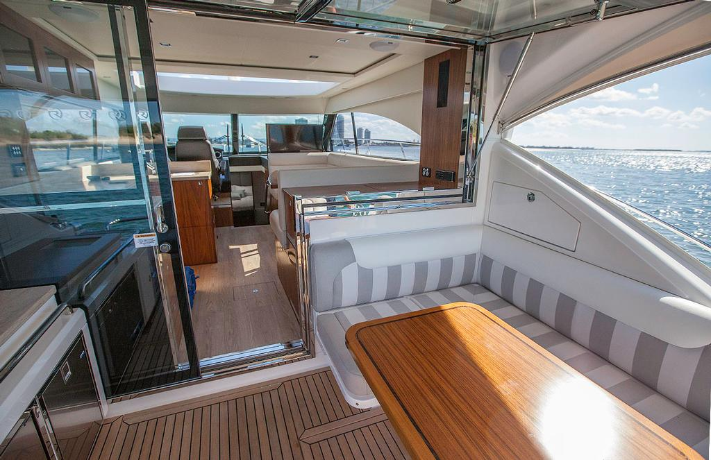 Terrific al fresco dining is a benefit of one-level boating like this. - Riviera 4800 Sport Yacht ©  John Curnow