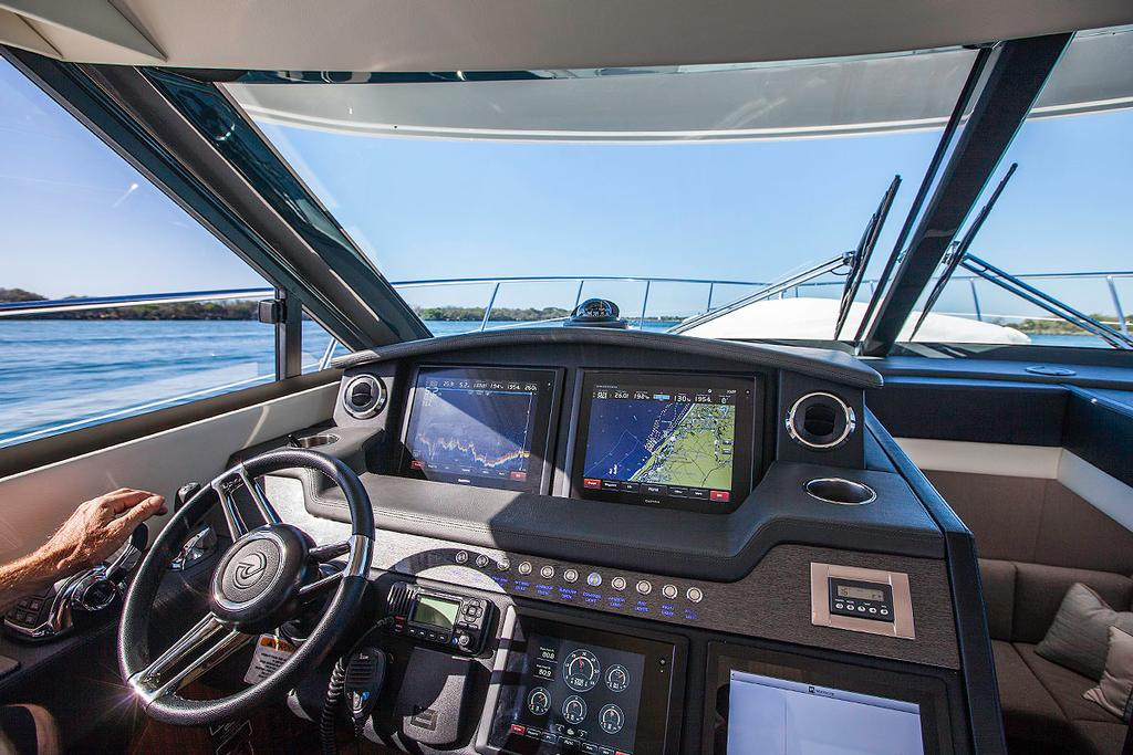 Off we go! Command position is well positioned and there is a plethora of material available from the three main displays. - Riviera 4800 Sport Yacht ©  John Curnow