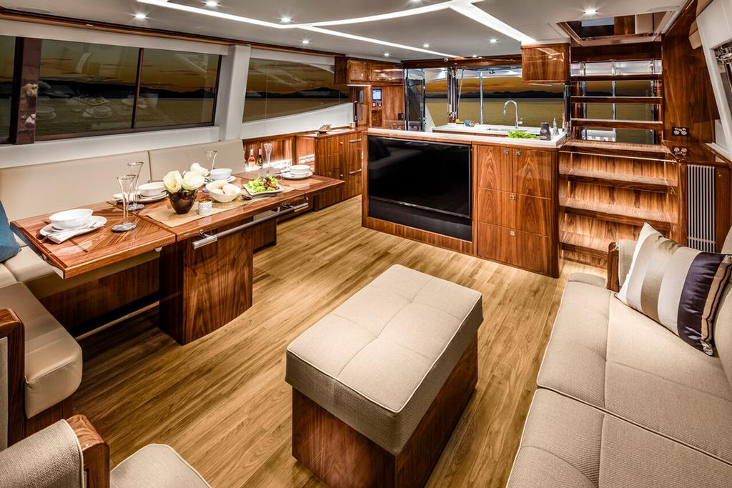 Saloon and galley form one large entertaining space on board the Riviera 68 Sports Motor Yacht. © Riviera Australia