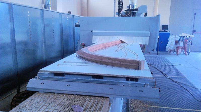 The CNC machine has introduced a camber into both sides at the stem so the planks will butt up against a flat surface when they are fitted. - photo © WSI